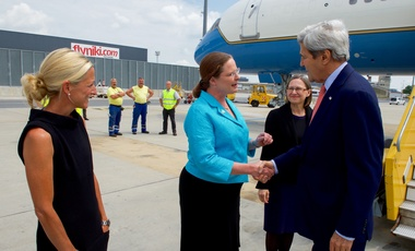 U.S. Secretary of State John Kerry shakes hands with the U.S. Representative to the Vienna Office of the United Nations and the International Atomic Energy Agency Ambassador Laura Holgate on July 22, 2016, after arriving at Vienna International Airport in Vienna, Austria, to attend a meeting aimed at amending the Montreal Protocol climate change agreement. (Dept. of State)