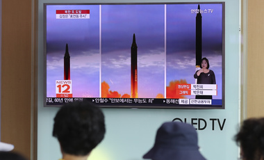 People at Seoul Train Station watch a a local news program reporting about a North Korean missile launch. Aug. 30, 2017 (Lee Jin-man/Associated Press).