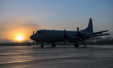 A 10 Squadron AP-3C awaits its crew as the sun rises over RAAF Base Edinburgh, Australia.