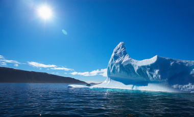Sun shining over iceberg in the Arctic Ocean