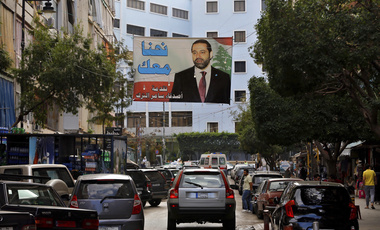 A poster of Prime Minister Saad Hariri hangs on a street in Beirut, Lebanon