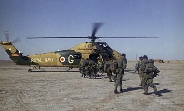 British troops board a helicopter