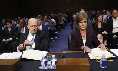 Former acting Attorney General Sally Yates and former National Intelligence Director James Clapper take their seats on Capitol Hill