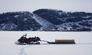 snowmobile pulling a sled