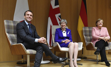 British Prime Minister Theresa May, center, German Chancellor Angela Merkel, right, and French President Emmanuel Macron, left
