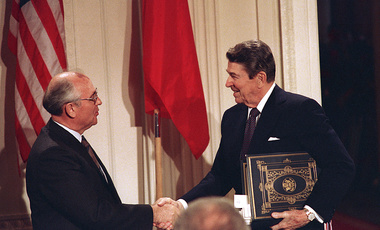 U.S. President Ronald Reagan, right, shakes hands with Soviet leader Mikhail Gorbachev