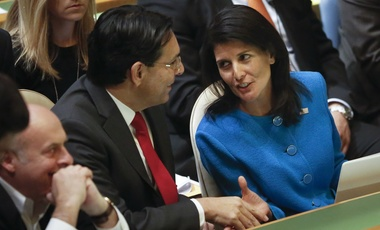 U.S. United Nations Ambassador Nikki Haley, right, and Israel's U.N. Ambassador Danny Danon exchange handshakes