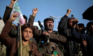 Houthi supporters chant slogans