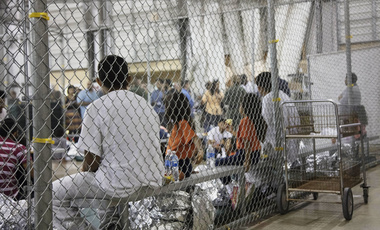 people who've been taken into custody related to cases of illegal entry into the United States, sit in a cage