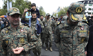 Members of the Iran's powerful Revolutionary Guards attend a rally against the U.S.'s decision to designate the guard as a foreign terrorist organization