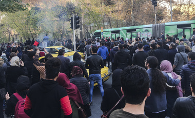 Demonstrators attend a protest over Iran's weak economy in Tehran