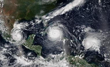 Satellite image of Hurricane Katia (left) making landfall over the Mexican state of Veracruz, Hurricane Irma (center) approaching Cuba, and Hurricane Jose reaching peak intensity