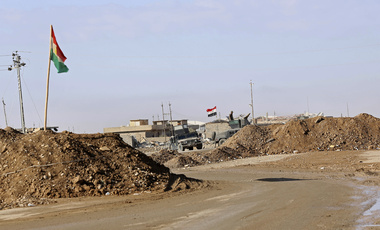 raqi Army checkpoint flying an Iraqi flag next to a Kurdish checkpoint with a Kurdish flag, outside Irbil, northern Iraq