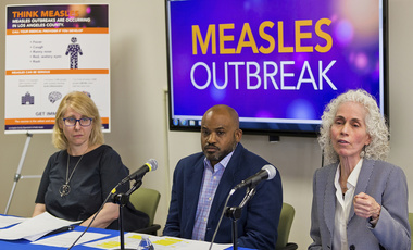 Los Angeles County Department of Public Health experts, from left, Dr. Sharon Balter, Director of Acute Communicable Disease Control, Muntu Davis, Health Officer, and Dr. Barbara Ferrer, Director, answer questions