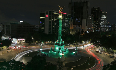 Angel of Independence monument, lit up in green in Mexico City
