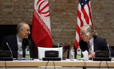 U.S. Secretary of Energy Ernest Moniz and Head of the Iranian Atomic Energy Organization Ali Akbar Salehi, left, meet at an hotel in Vienna, July 9, 2015