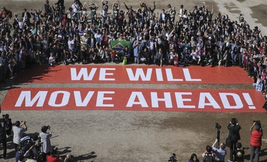 Participants at the COP22 climate conference stage a public show of support for climate negotiations and Paris agreement