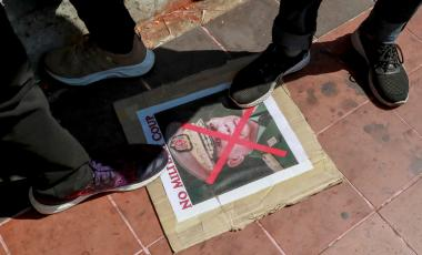 Demonstrators step on a defaced image of Myanmar military Commander-in-Chief Senior Gen. Min Aung Hlaing