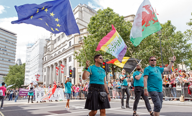 A man in a kilt parades the flag of the European Union at Pride in London 2016