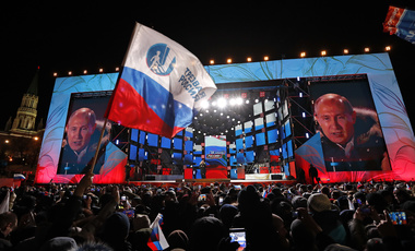 Russian President Vladimir Putin speaks to supporters during a rally near the Kremlin