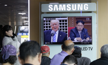 TV screen shows images of U.S. President Donald Trump, left, and North Korean leader Kim Jong Un during a news program at the Seoul Railway Station in Seoul, South Korea