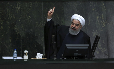 Iranian President Hassan Rouhani speaks while submitting his next year's budget bill in an open session of parliament in Tehran