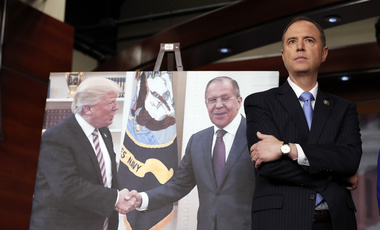 Rep. Adam Schiff stands next to a photograph of President Donald Trump and Russian Foreign Minister Sergey Lavrov