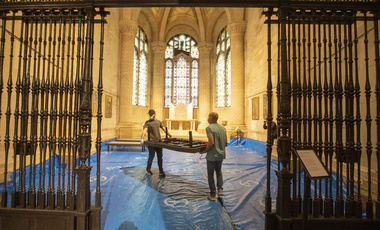 Volunteers place beds in a chapel