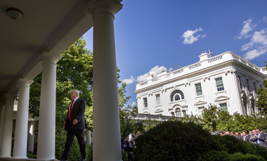 Donald Trump walks to the Oval Office from Rose Garden