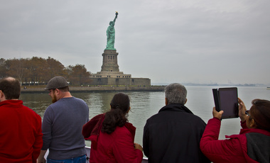Tourists view Statue of Liberty
