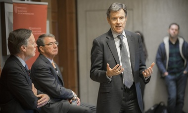 "During, ""Intelligence gathering in the 21st century,"" Nick Burns (from left) and Ash Carter listen as John Sawers, former head of MI6, discusses the challenges of the modern intelligence industry."