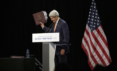 U.S. Secretary of State John Kerry reacts as he leaves a news conference at the Vienna International Center in Vienna , Austria Tuesday July 14, 2015.