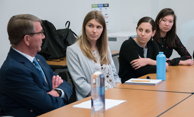 Belfer Center Director Ash Carter speaks with 2018-2019 IGA Student Fellows (from left) Raina Davis, Jenna Stark, and Bo Julie Crowley.