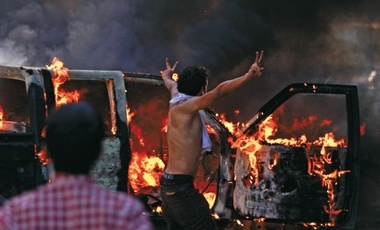Egyptian protestors burn cars as outrage continues over a film depicting the Prophet Muhammad.