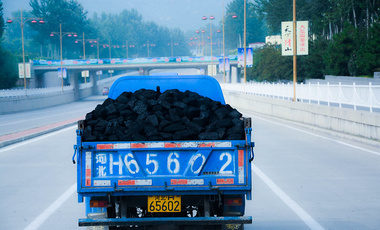 Truck transporting coal on a smoggy day in Beijing