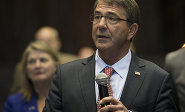 Defense Secretary Ash Carter speaks with members of the media after delivering remarks at the National Full-Scale Aerodynamics Complex at Moffett Field, Calif., Aug. 28, 2015.