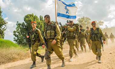 Soldiers from the IDF Home Front Command's Search and Rescue Brigade complete their beret march in southern Israel after finishing eight months of training, October 4, 2014.