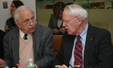 James Schlesinger (right), a member of the Belfer Center International Council, makes a point to Nobel Laureate Roy L. Glauber at a Center seminar in which Schlesinger spoke on the role of oil in national security.