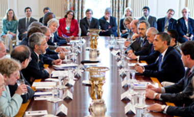 John P. Holdren (center left), director of the White House Office of Science and Technology Policy, makes a point to President Barack Obama (center right) at the first meeting of the President's Council of Advisors on Science and Technology in August.
