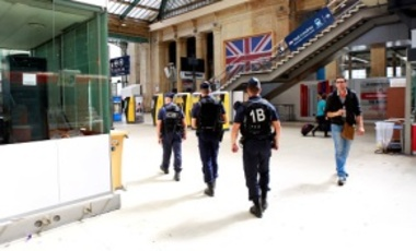 Military and police security patrol Gare du Nord station in Paris, France.