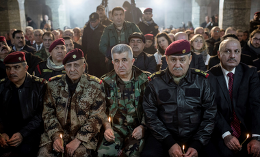 Iraqi Army and Peshmerga commanders attend Christmas Eve's Mass in the Assyrian Orthodox church of Mart Shmoni, in Bartella, Iraq, Saturday, December 24, 2016.