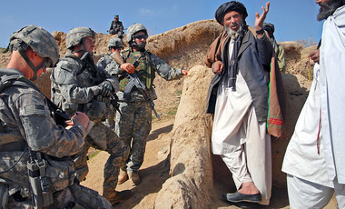 U.S. Army 1st Lt. Jared Tomberlin, second from left, Bravo Company, 1st Battalion, 4th Infantry Regiment, U.S. Army Europe, speaks with village elders during a key leader engagement in a town near Forward Operating Base Lane, Zabul, Afghanistan, March 5, 2009.