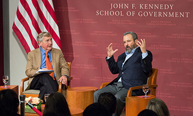 Former Israeli Prime Minister Ehud Barak gestures while speaking with Center Director Graham Allison during Barak's Lamont Lecture on Middle East challenges at a  JFK Jr. Forum.