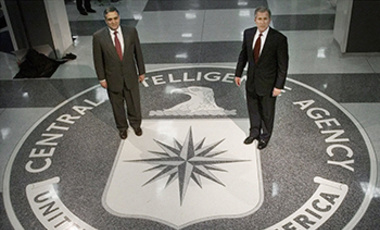 This March 20, 2001 file photo, shows President George W. Bush, right, and George J. Tenet, left, director of the Central Intelligence Agency, stop to pose standing the CIA seal in the main entrance of agency headquarters in Langley, Va.