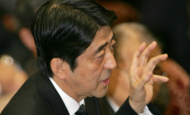 Japanese Prime Minister Shinzo Abe responds to questions delivered by opposition leader Ichiro Ozawa during a Parliamentary debate. Abe insisted his government would not stray from its non-nuclear policy.