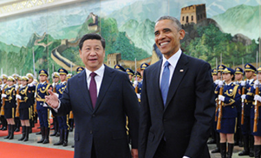 U. S. President Barack Obama (R) and Chinese President Xi JinPing review the guard of honor during a welcome ceremony at the Great Hall of the People in Beijing, China on Nov. 12, 2014.