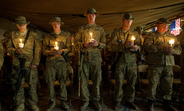 Soldiers with the U.S. Army's 25th Infantry Division, 3rd Brigade Combat Team, 2nd Battalion 27th Infantry Regiment based in Schofield Barracks, Hawaii, hold a ceremony commemorating the 10th anniversary of the 9/11 attacks and soldiers the unit has lost.