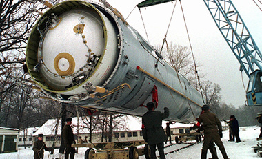 In this Wednesday, Dec. 24, 1997 file photo, soldiers prepare to destroy a ballistic SS-19 missile in the yard of the largest former Soviet military rocket base in Vakulenchuk, Ukraine, 220 kilometers (137 miles) west of Kiev. (AP Photo)