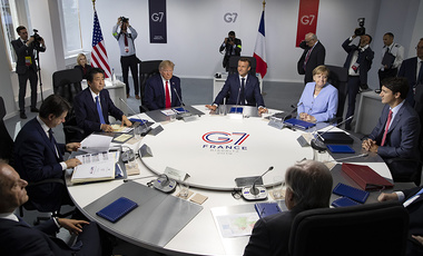 Aug.26 2019, file photo, from the left, Italian Prime Minister, Giuseppe Conte, Japanese Prime Minister Shinzo Abe, U.S President Donald Trump, French President Emmanuel Macron, German Chancellor Angela Merkel, Canadian Prime Minister Justin Trudeau, Britain's Prime Minister Boris Johnson attend a work session during the G7 summit at Casino in Biarritz, southwestern France.