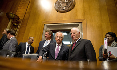 Senate Foreign Relations Committee Chairman Sen. Bob Corker, R-Tenn., center, speaks with the committee's ranking member Sen. Ben Cardin, D-Md., on Capitol Hill in Washington In this April 14, 2015 file photo.